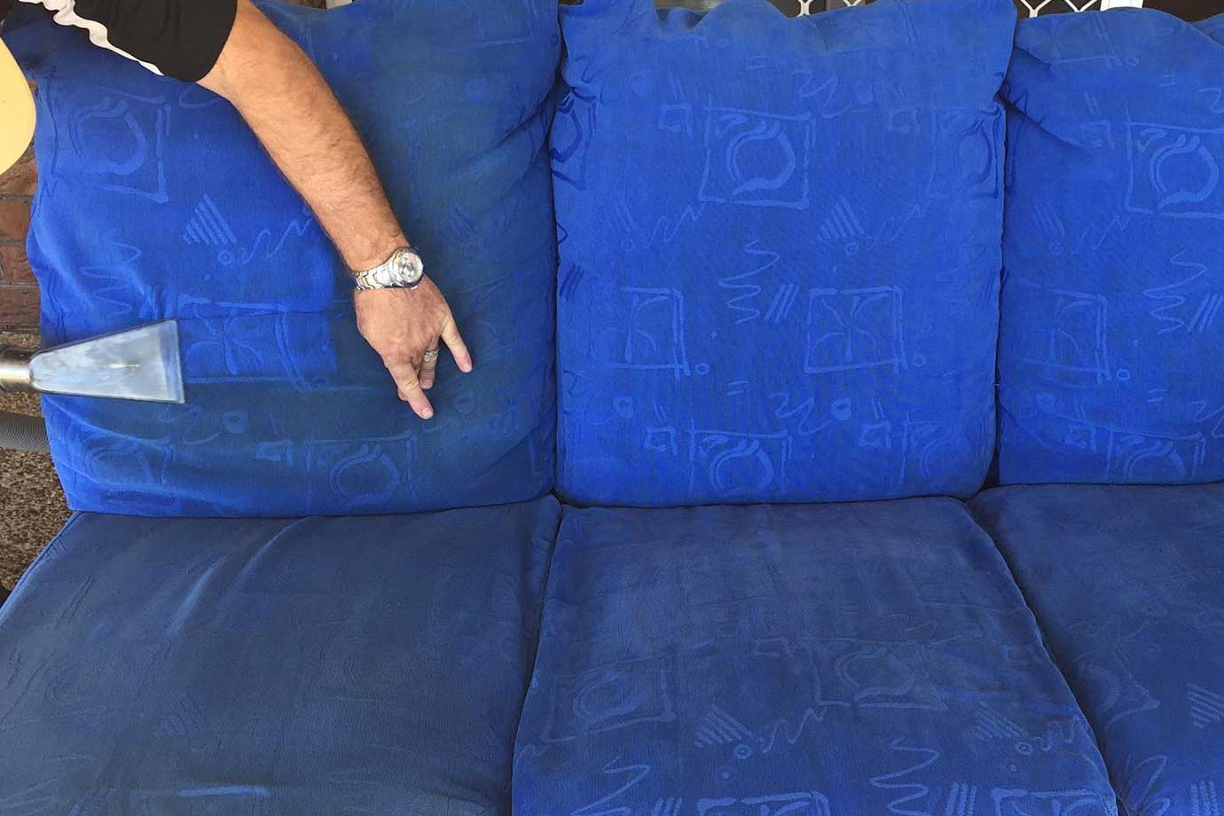 team member upholstery cleaning a 3 seater lounge the butler cleaning co gatton